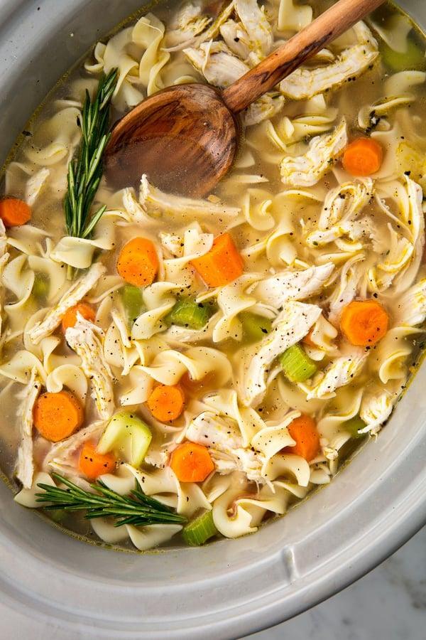 crock pot of chicken noodle soup