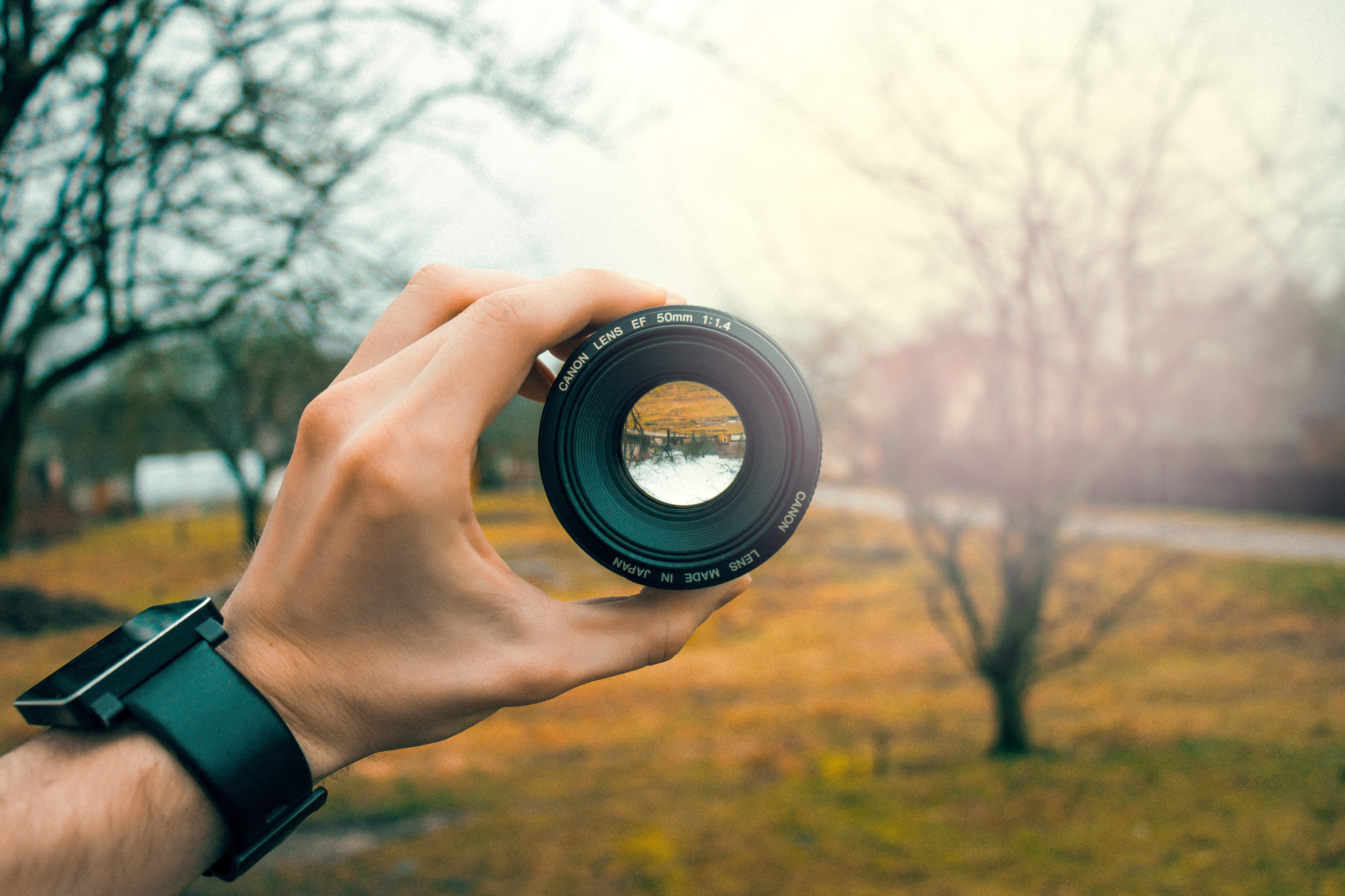 a camera lens focuses on something in the distance