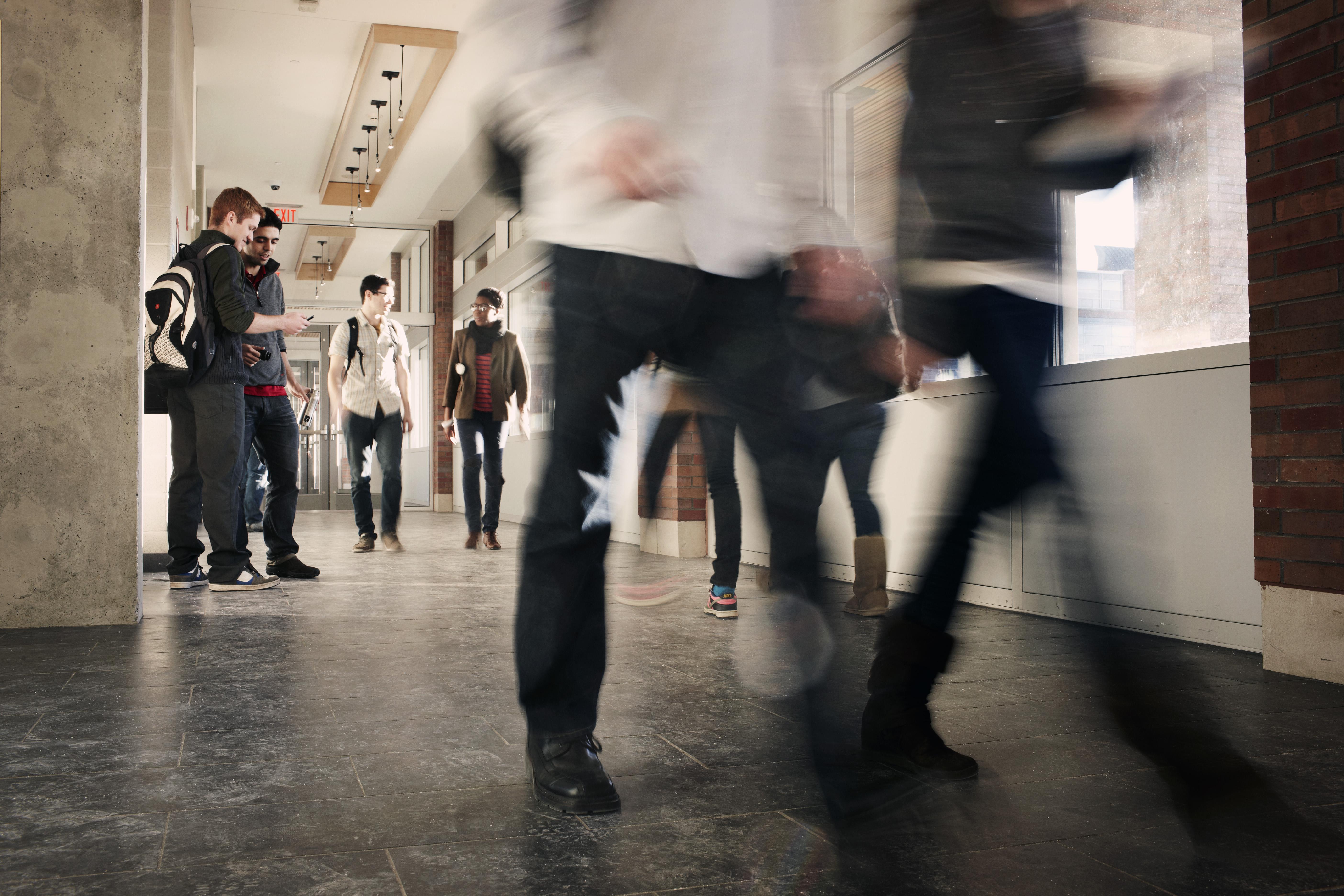 Students walking in a hallway