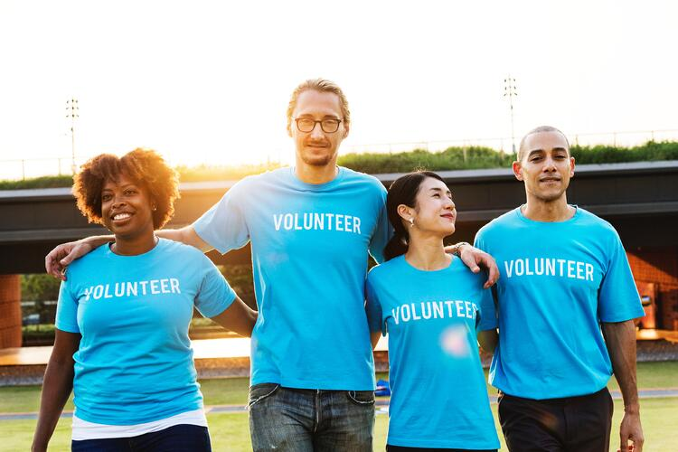 Four people with blue volunteer shirts